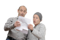 Letter. Shocked couple reading an announcement letter Royalty Free Stock Image
