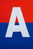 Letter A sign. White letter A sign on red and blue background Stock Photo