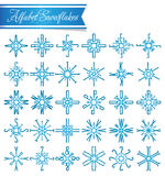 Letter snowflakes Stock Photos
