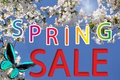Letter spring sale with butterfly and white flowers Stock Photography