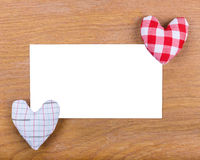 Letter template for greeting Happy Valentine's day on a wooden surface. White isolated paper letters with hearts. Royalty Free Stock Photography