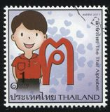 The letter of the Thai alphabet. RUSSIA KALININGRAD, 3 JUNE 2016: stamp printed by Thailand shows The letter of the Thai alphabet, circa 2011 stock photography