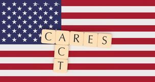 Free Letter Tiles CARES Act On US Flag, 3d Illustration Stock Photos - 177092243