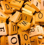 Letter tiles for the game of Scrabble. An up close photo of wooden letter tiles for the game of Scrabble stock image