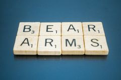 Second Amendment Scrabble Letter Tiles. Letter tiles spelling out The right to bear arms, a key portion of the United States of America`s second amendment to the Royalty Free Stock Photo