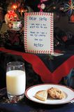 Letter to Father Christmas with biscuits and milk. Royalty Free Stock Photo