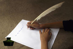 The letter to the friend. To write the letter to the friend a goose feather Stock Photography