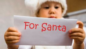 Letter to Santa. The small child read the letter to Santa Stock Photo
