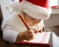 Letter to Santa. The small child writes the letter to Santa Stock Image