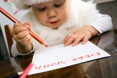Letter to Santa. The small child writes the letter to Santa Royalty Free Stock Photography