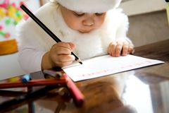 Letter to Santa. The small child writes the letter to Santa Royalty Free Stock Photos
