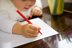 Letter to Santa. The small child writes the letter to Santa Stock Images