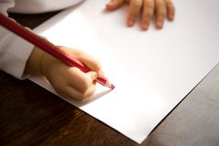 Letter to Santa. The small child writes the letter to Santa Stock Photography