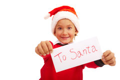 Letter to Santa. Happy lad holding letter with note �To Santa� in isolation Royalty Free Stock Image