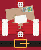 Letter to santa. Close up of santa holding a letter left blank for your message Stock Images