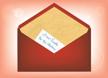 Letter to Santa. Christmas childs message inside a letter to Santa (red envelope with recycled paper Stock Images
