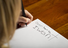 Letter to Santa. A child writing a letter to Santa before Christmas Royalty Free Stock Image