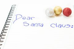 Dear santa claus. Letter to Santa Claus with Christmas balls. White background. isolated Stock Images