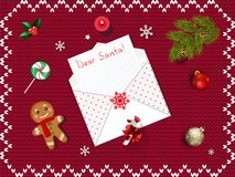 Letter to Santa Claus. Christmas card with opened envelope with. Copyspace, candies, balls, gingerbread man, fir tree on red knitted background. Christmas Royalty Free Stock Photography