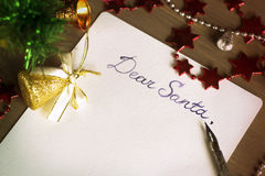 Letter to Santa Claus, Dear Santa, Christmas still life. Letter to Santa Claus. Dear Santa. Christmas still life and background. A sheet of paper on a wooden Stock Photo