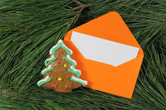 Letter to Santa Claus, envelope with gingerbread on fir tree Royalty Free Stock Photos