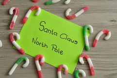 A letter to Santa Claus at the North Pole with candy canes. On a wooden table Stock Images