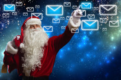 Letter to Santa. Santa Claus reading children letters with wishes Stock Photography