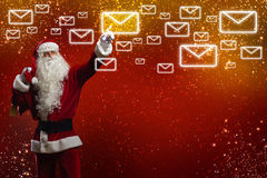 Letter to Santa. Santa Claus reading children letters with wishes Stock Images