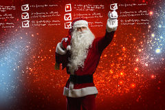 Letter to Santa. Santa Claus reading children letters with wishes Stock Photo