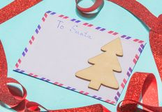 Letter to santa claus a letter of wish list on a blue background. Envelope to Santa claus on a blue background. Lay flat Stock Photography