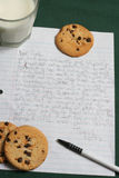 Letter to Santa Clause, Vertical image. Little kid Letter to Santa Clause asking for gifts. On a hunter green table cloth with cookies and milk. Vertical Image Stock Images