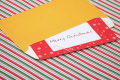 Letter to santa in an envelope. Letter to santa tucked in an envelope ready to send to the north pole Stock Photos