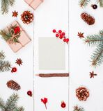 Letter to Santa on holiday background with Christmas gifts, Fir. Branches, pine cones, red decorations. Xmas and Happy New Year composition. Flat lay, top view Royalty Free Stock Photos