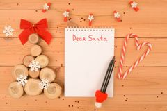 A letter to Santa. a wooden Christmas tree royalty free stock photo
