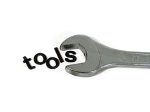 Letter Tools. Letters spelling the word tools inside a box spanner Stock Photos
