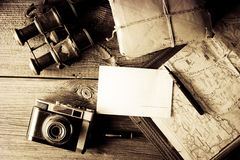 Letter from travel. Concept - old mapholder, camera and binoculars with vignette Royalty Free Stock Photo