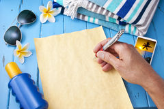 Letter Travel Vacation Holiday. A letter being written home from a tropical vacation setting Stock Photos