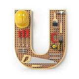 Letter U. Alphabet from the tools on the metal pegboard isolated Stock Photography