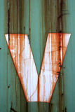 The letter V. On a rusty container Royalty Free Stock Images