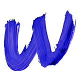 Letter W drawn with blue paints Royalty Free Stock Photography