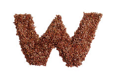 Letter W made with Linseed also known as flaxseed isolated on wh Royalty Free Stock Photography