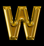 Letter W rounded shiny golden isolated on black. Background Stock Images