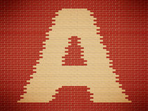 Letter A on wall. White letter A on red brick wall Royalty Free Stock Photos