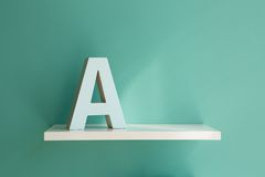 Letter A on a white shelf Stock Photos