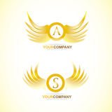 Letter wings gold golden logo Stock Photo