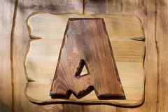 Letter A on a wooden plate Royalty Free Stock Photos