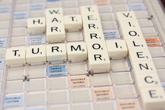 Letter Word Game Tiles. Word game tiles spell out game related words in a crossword puzzle fashion.  Words spelled are Hate, War, Violence, Terror and Turmoil Stock Photography