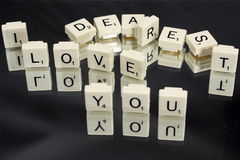 Letter Word Game Tiles. Word game tiles spell out the words Dearest, I love you..  Reflection is mirrored against a black background Stock Image