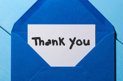 Letter with the words thank you at blue envelope stock photography