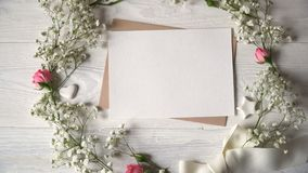 Letter with wreath of flowers greeting card for St. Valentine`s Day in rustic style with place for your text, Flat lay. Top view stock video footage